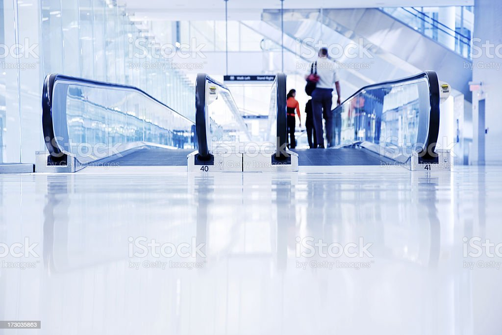 Airport Walkway with Travellers royalty-free stock photo