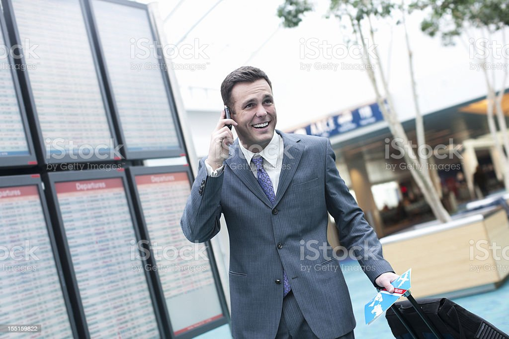Airport with Businessman Talking on Cell Phone, Copy Space royalty-free stock photo