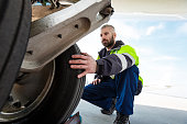 Airport worker checking tires