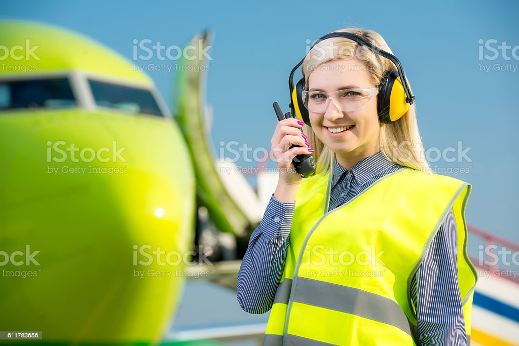 Airport worker with airplane on the background stock photo