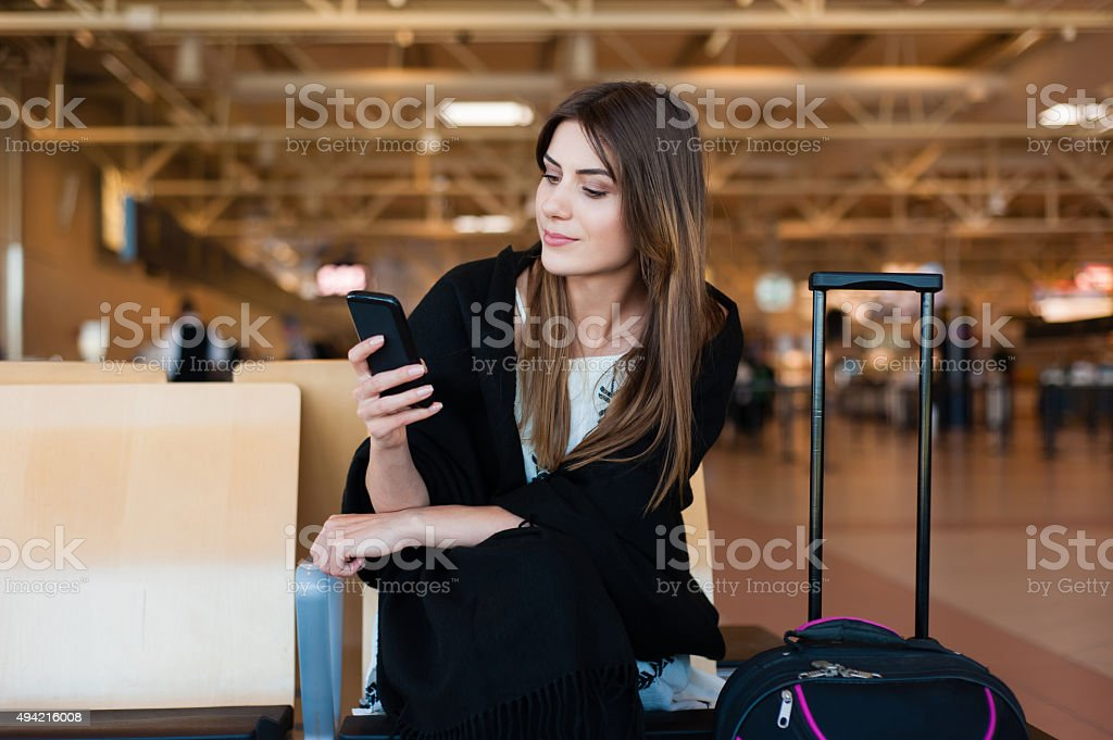 Airport Young female passenger stock photo