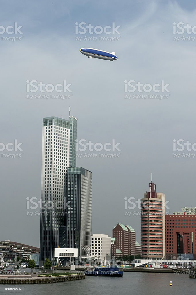 Airship above high rise stock photo