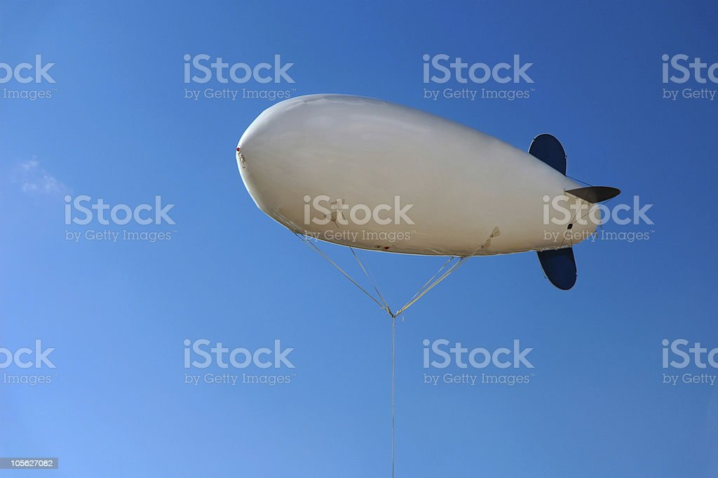 Airship Floating over Blue Sky stock photo