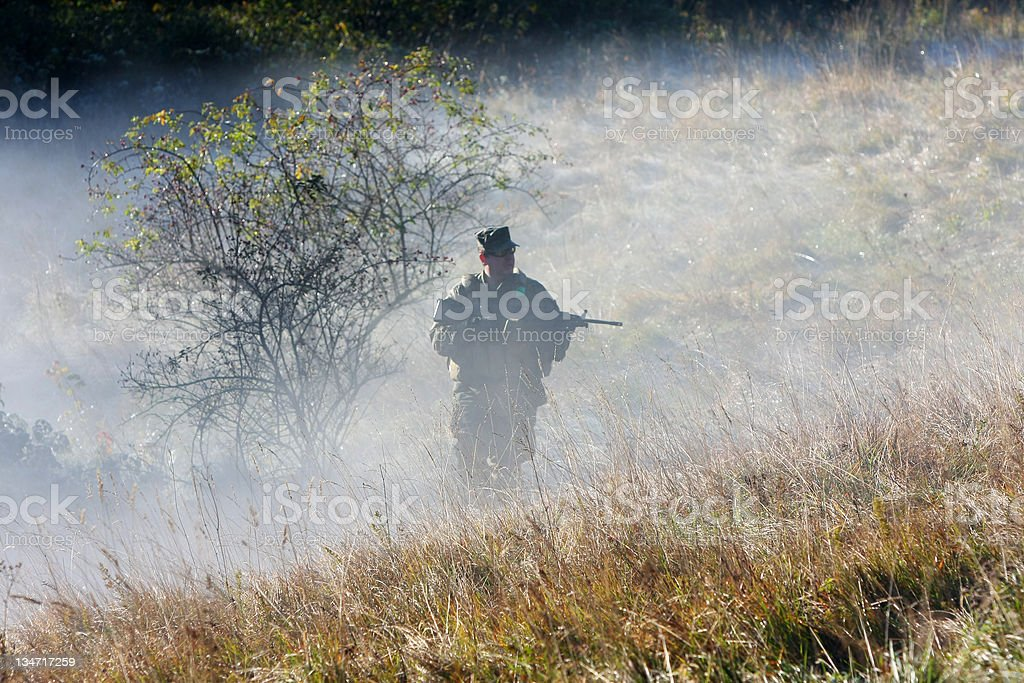 Airsoft game...Soldier in the mist royalty-free stock photo