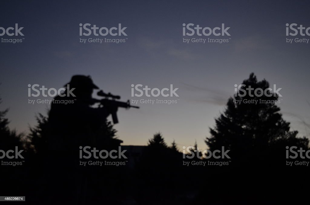 Airsoft man silhouette at afternoon stock photo