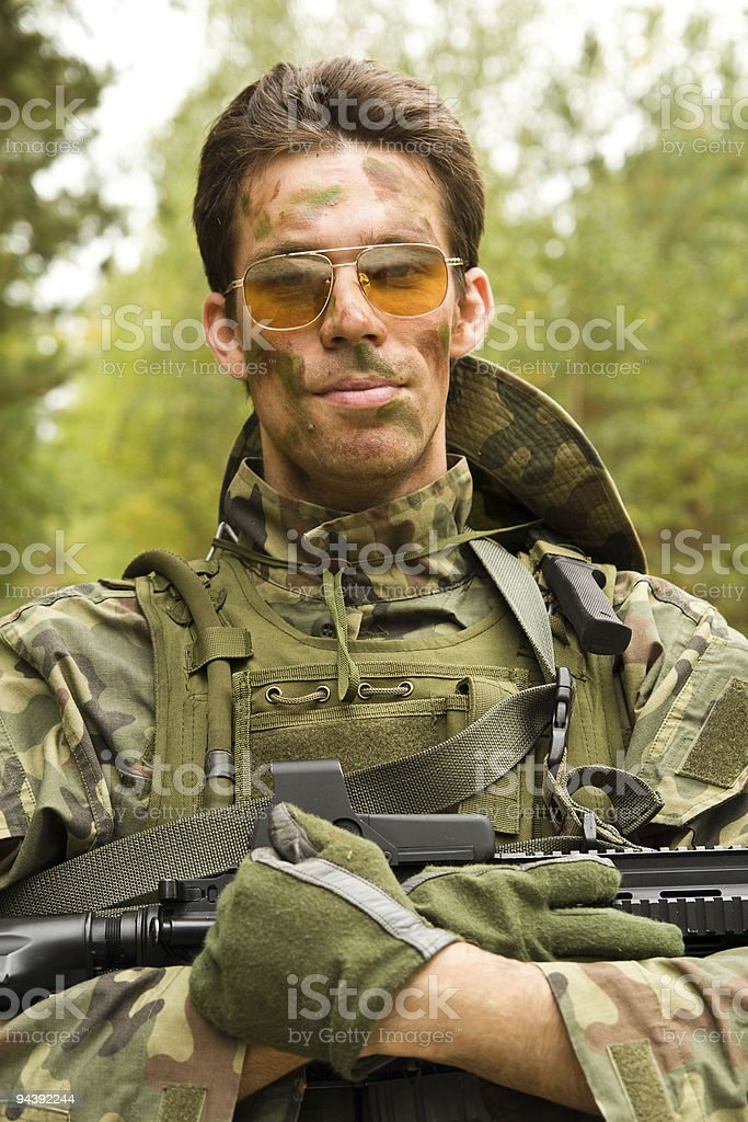 Airsoft player, man in camouflage with gun royalty-free stock photo