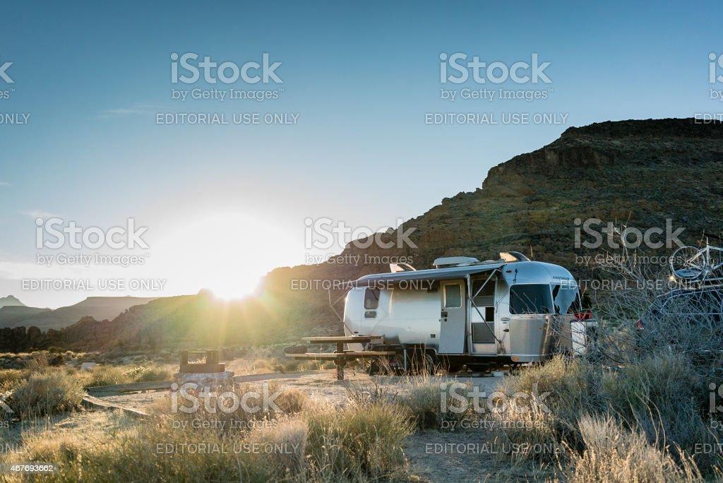 Airstream Trailer in Mojave Desert at Sunset stock photo