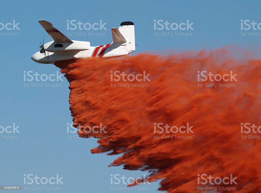 Airtanker dropping fire retardant. royalty-free stock photo