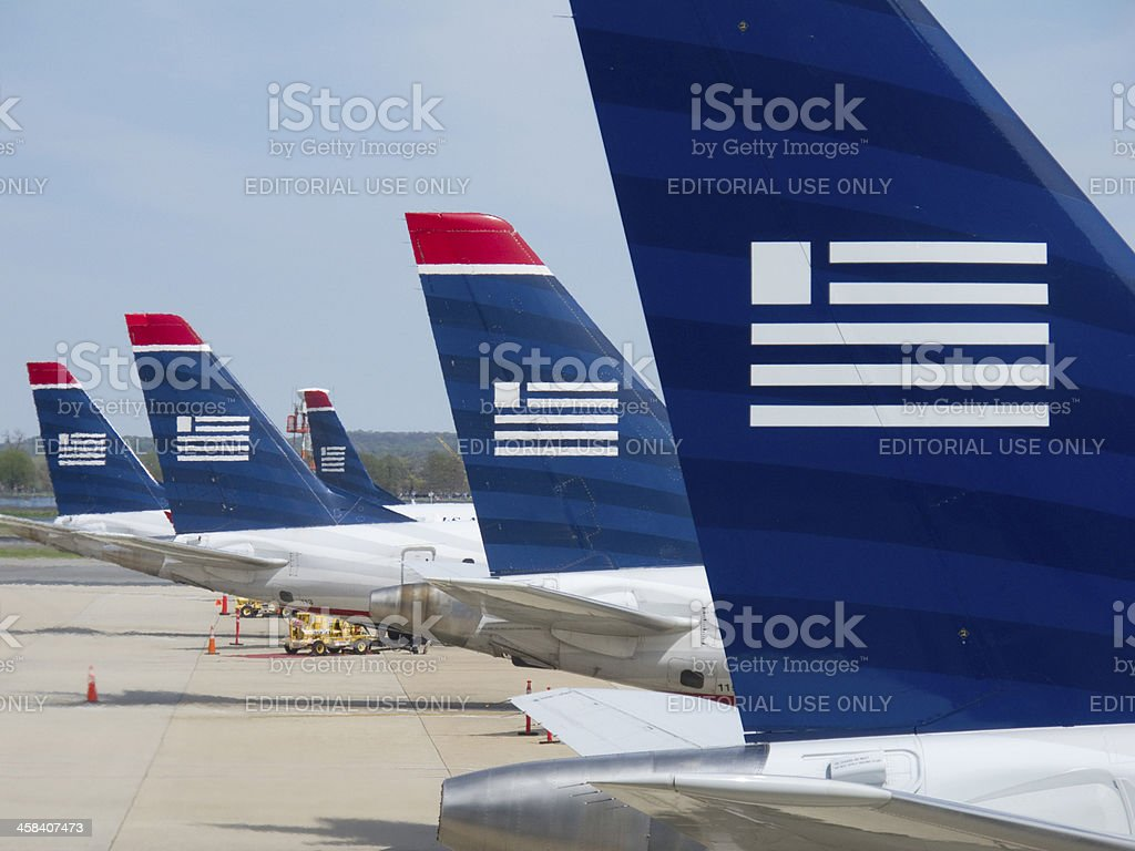 US Airways airplanes waiting at their gates. royalty-free stock photo