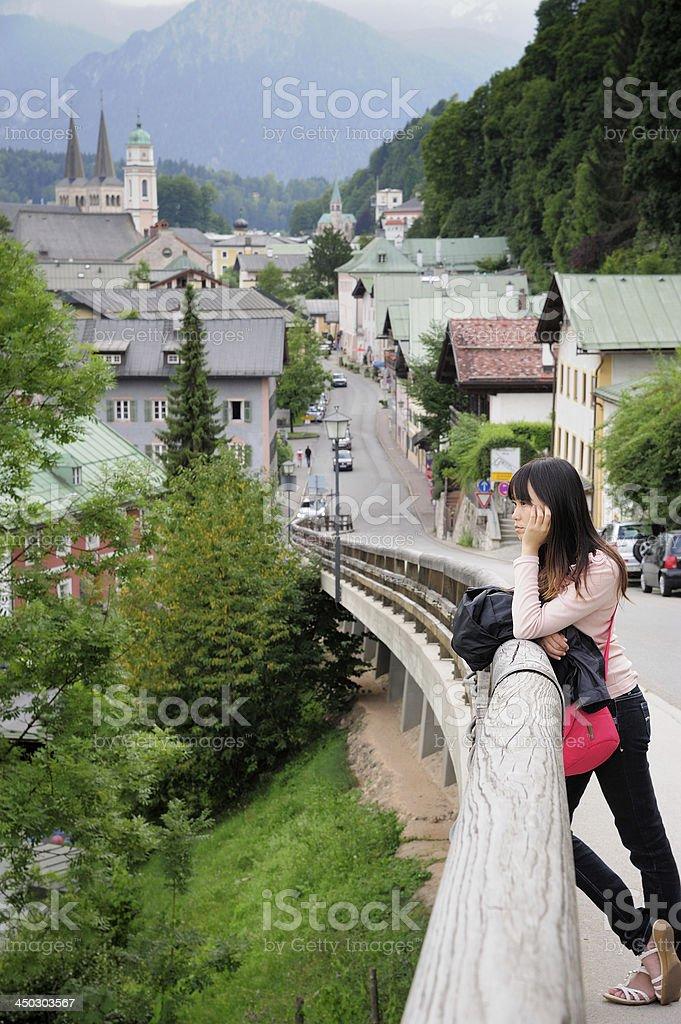 Aisan Woman with Berchtesgaden and Watzmann Mountains royalty-free stock photo
