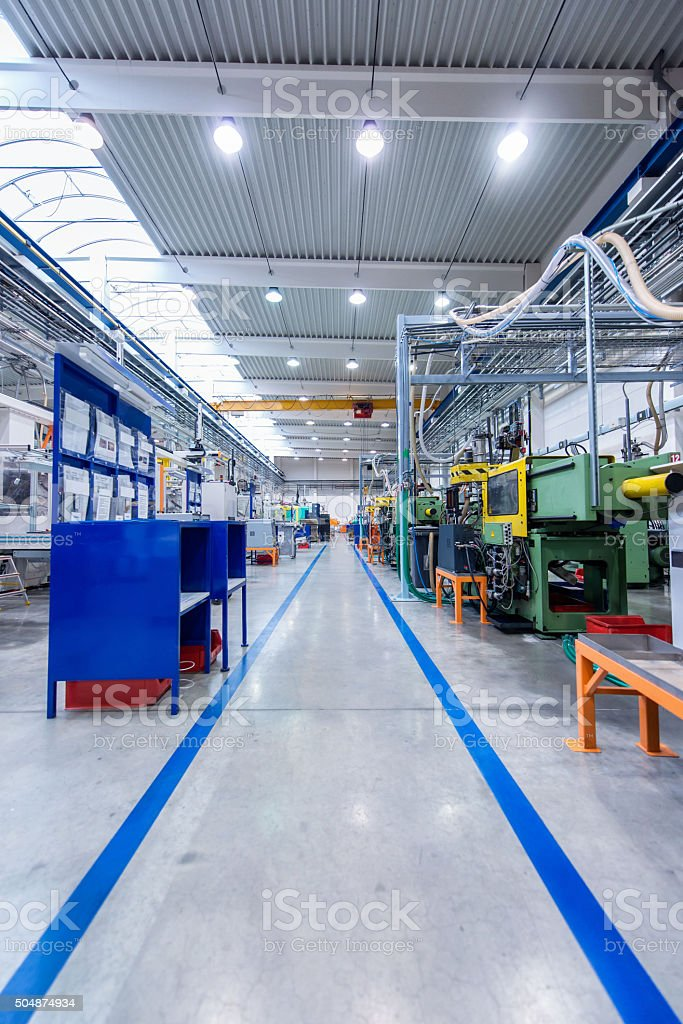 Aisle in large factory stock photo