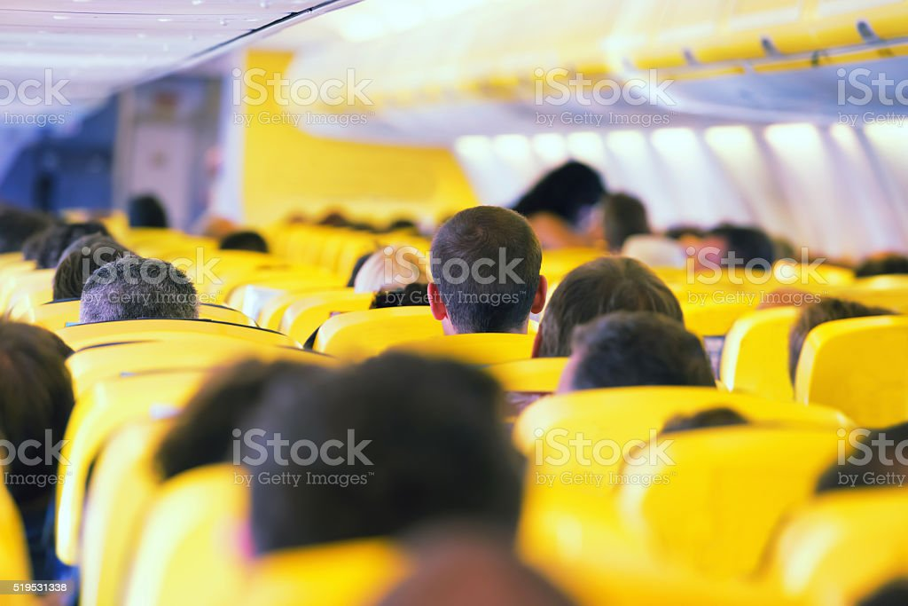 Aisle inside a plane stock photo