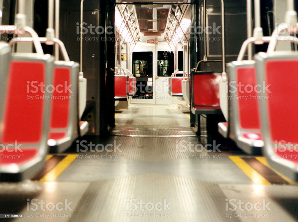 Aisle of subway train with red chairs royalty-free stock photo
