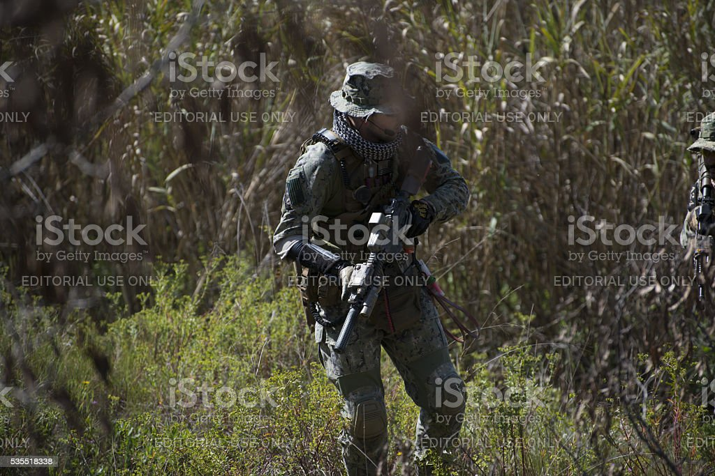 Aisoft player holding an automatic rifle stock photo