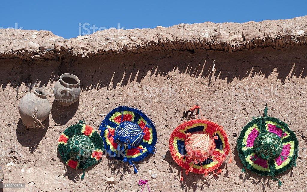 Ait Benhaddou hats and storage jar Morocco stock photo