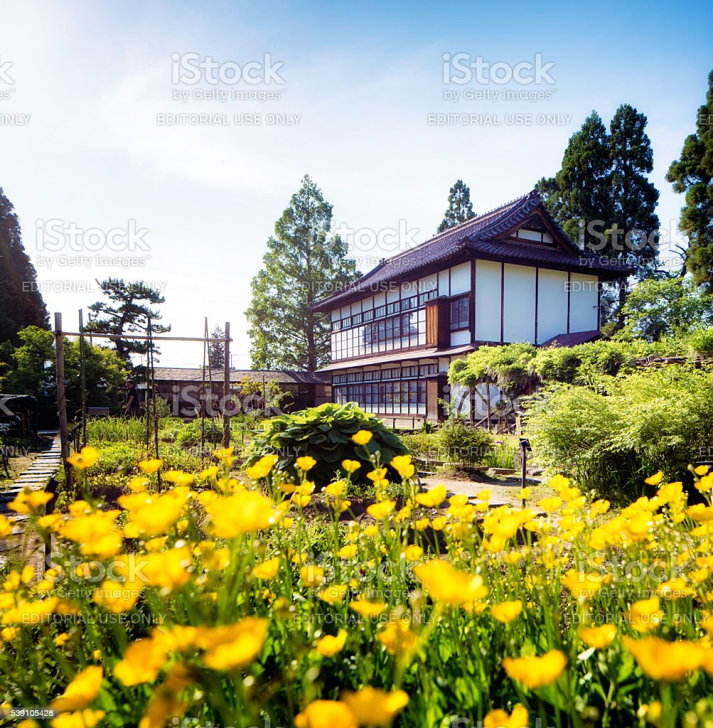 Aizuwakamatsu Oyakuen Garden maintenance building with poppies stock photo