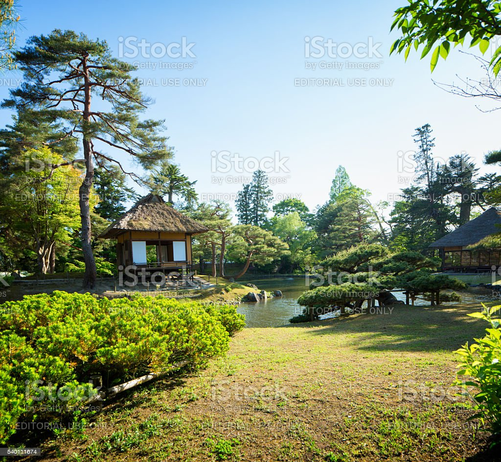 Aizuwakamatsu Oyakuen Garden pavilion with lawn and river stock photo