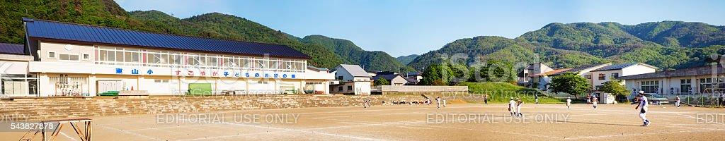 Aizwakamatsu elementary school panorama with baseball team practicing stock photo