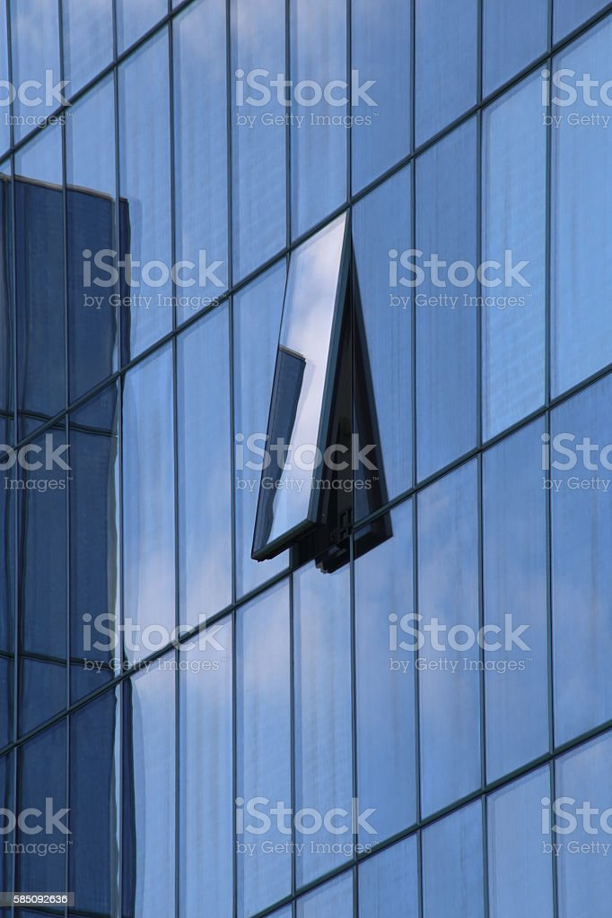 Ajar window on all-over glazing wall of modern building stock photo