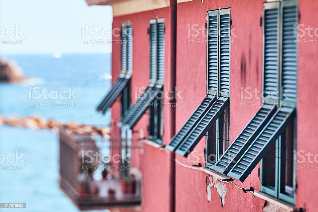 Ajar windows in sunny Italy stock photo