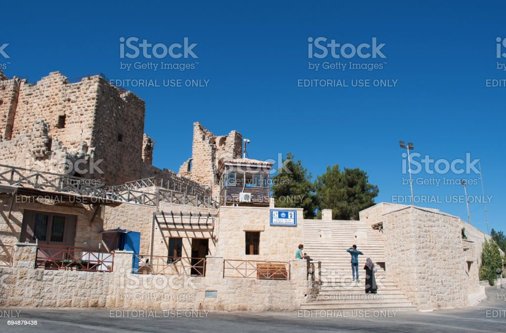 Ajloun: tourist at the Ajloun Castle, Muslim castle built by the Ayyubids in the 12th century, enlarged by the Mamluks, on a hilltop belonging to the Mount Alun district in the Jordan Valley stock photo