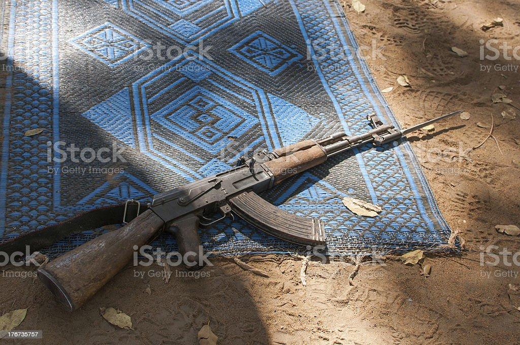 Ak47 gun on prayer mat stock photo
