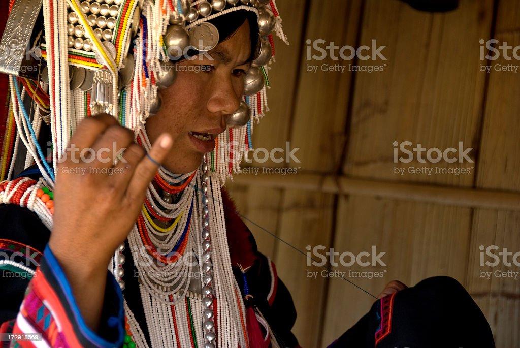 Akha Woman Hand Sewing royalty-free stock photo