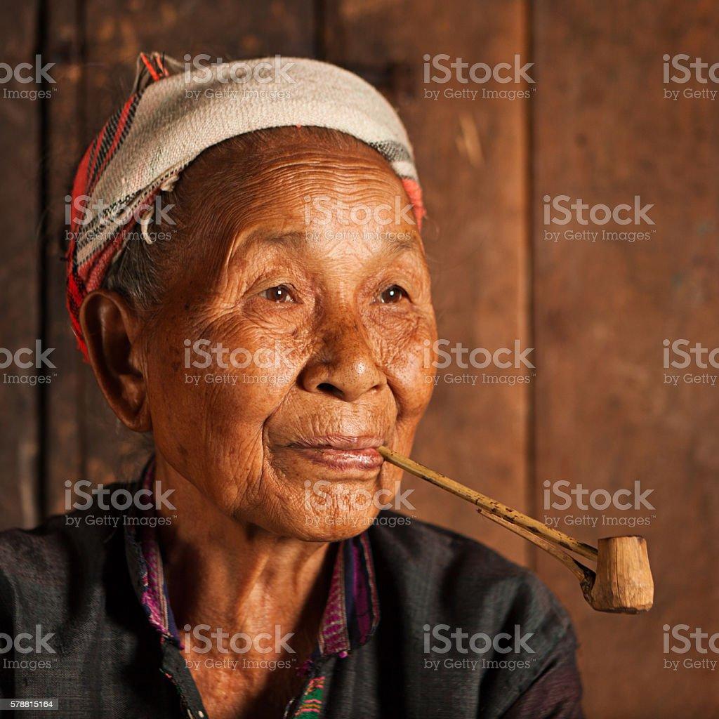 Akha woman smoking a pipe in Northern Laos stock photo