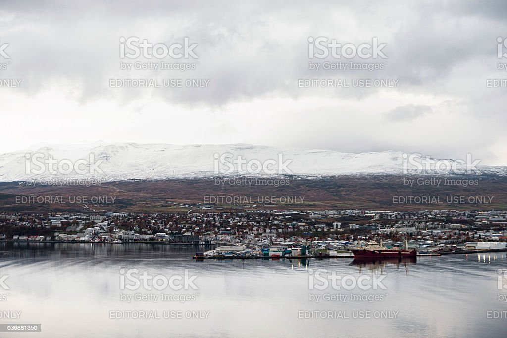 Akureyri City Cityscape with Port and Mountain in Background stock photo