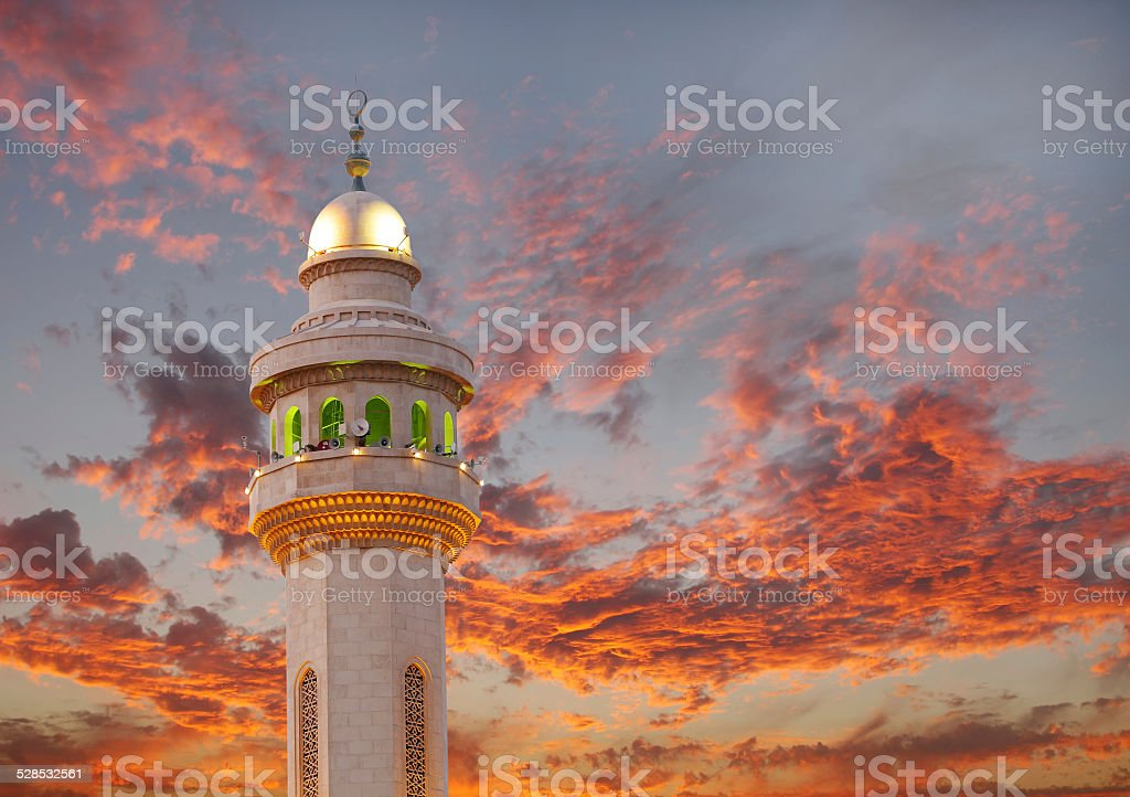 Al Fateh Mosque Minaret on dramatic cloud at sunset stock photo