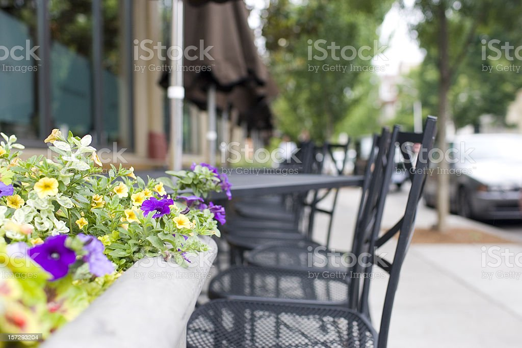 Al Fresco Dining Tables and Chairs with Flowers, Copy Space royalty-free stock photo