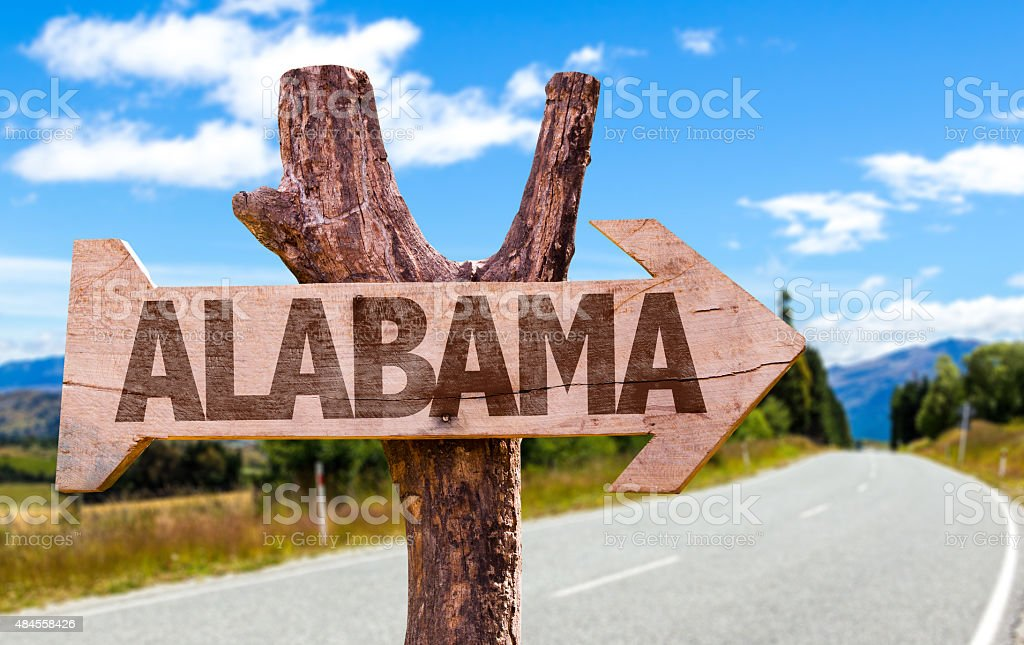 Alabama wooden sign with road background stock photo