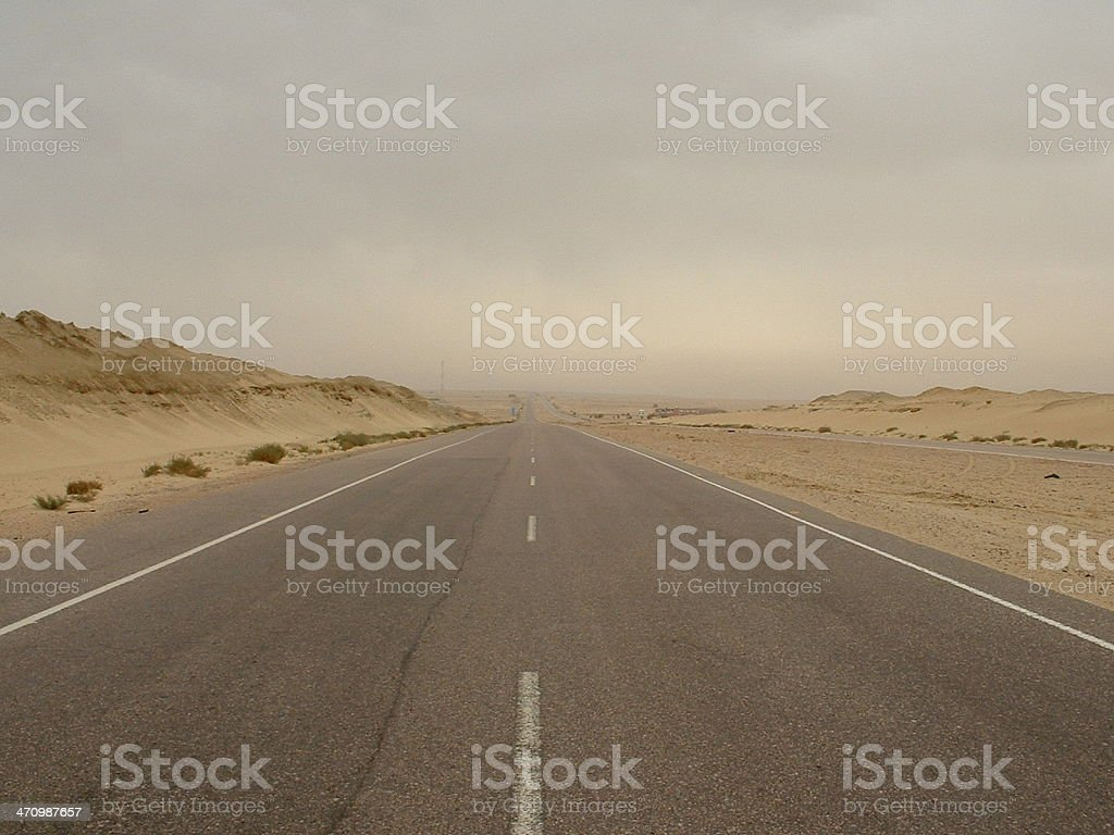 Alamein road in the middle of a sand storm stock photo