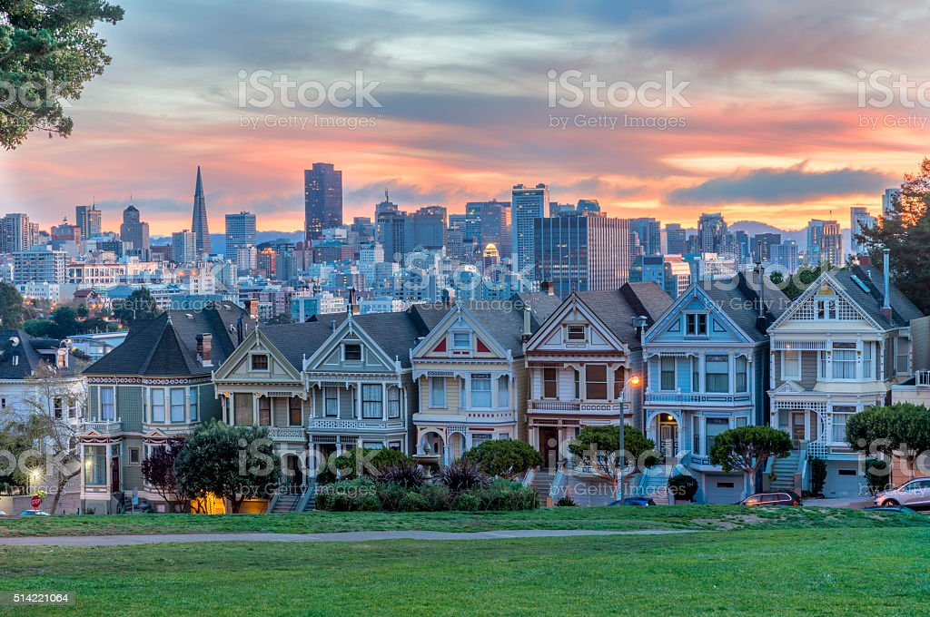 Alamo square and Painted Ladies with San Francisco skyline stock photo