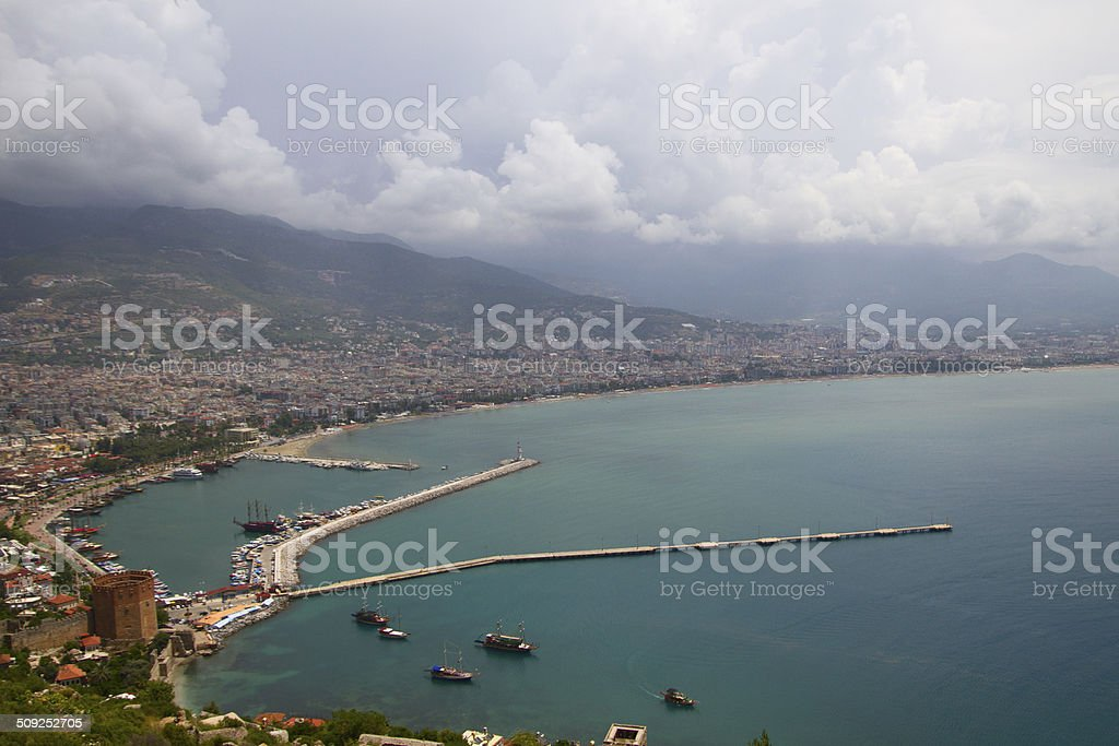 Alanya city, harbor and Kizil Kule tower from above stock photo