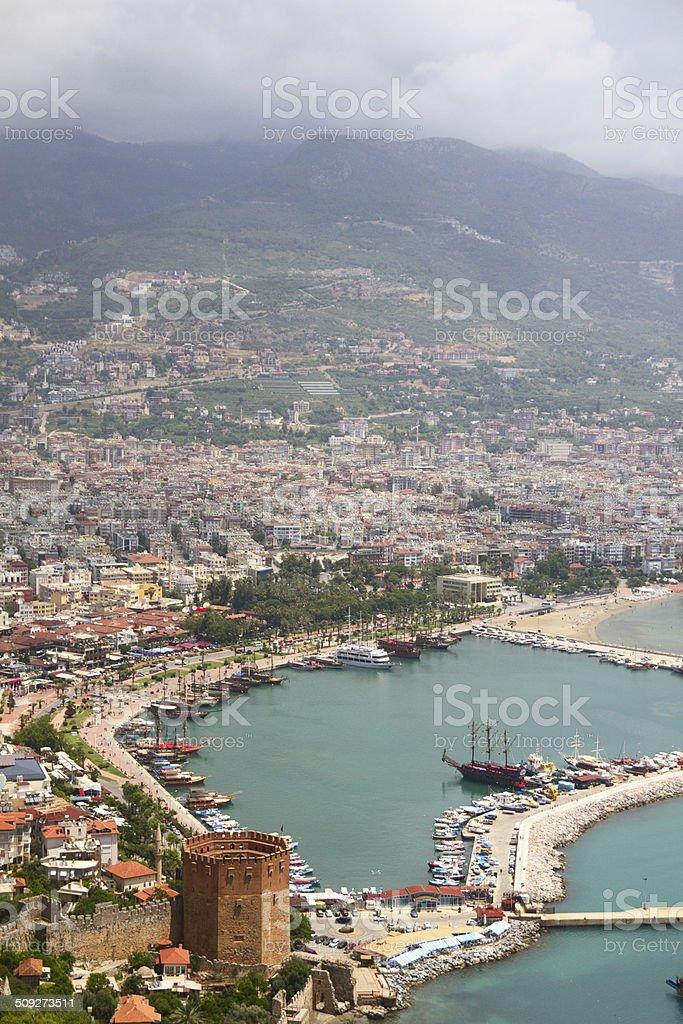 Alanya city, harbor and Kizil Kule tower stock photo