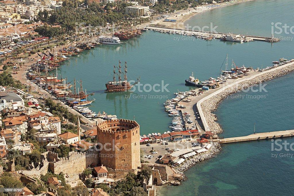 Alanya harbor and Kizil Kule tower stock photo