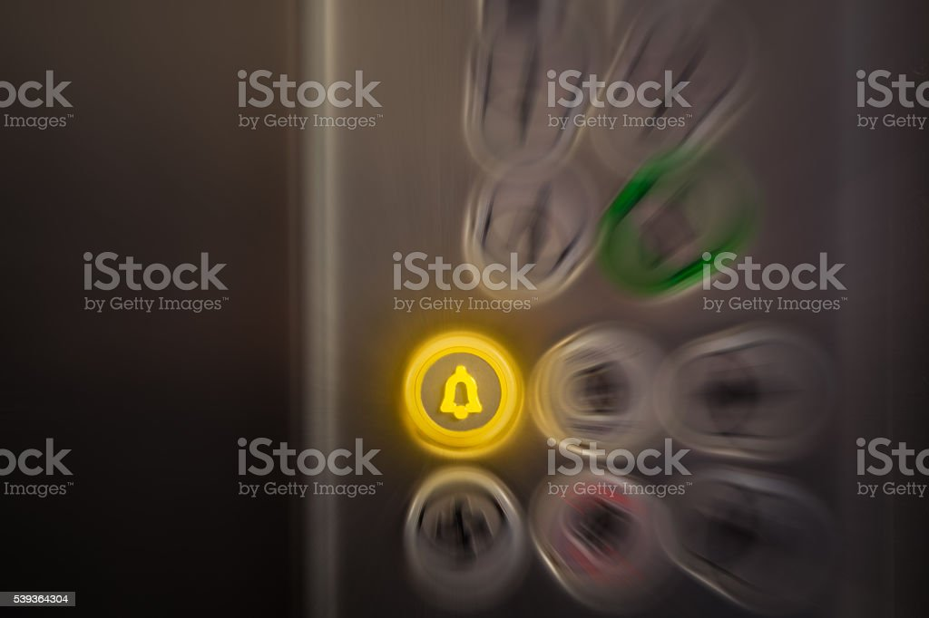 Alarm button on elevator control panel. Emergency concept. stock photo