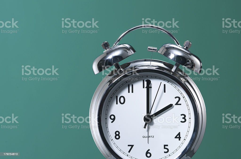 Alarm clock against Green stock photo