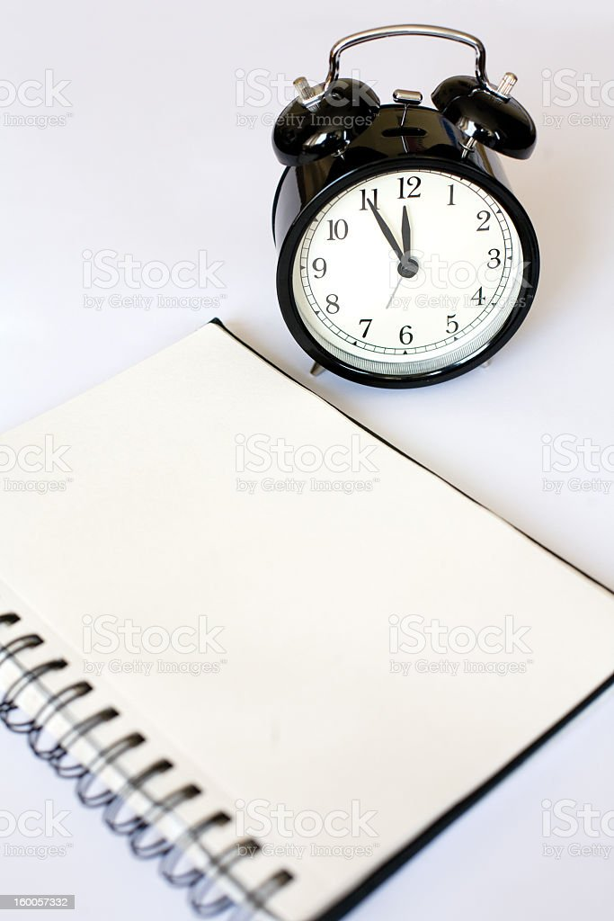 Alarm clock and a list of things to do stock photo