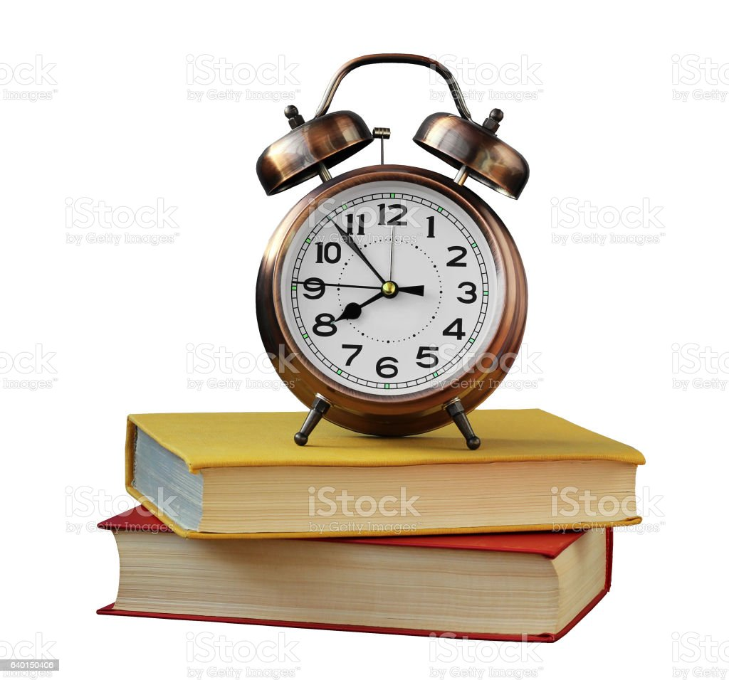 alarm clock and books isolated on white stock photo