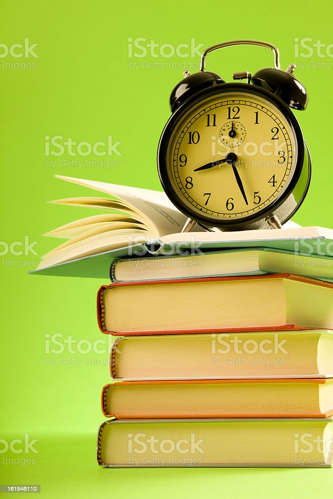 Alarm Clock and books royalty-free stock photo
