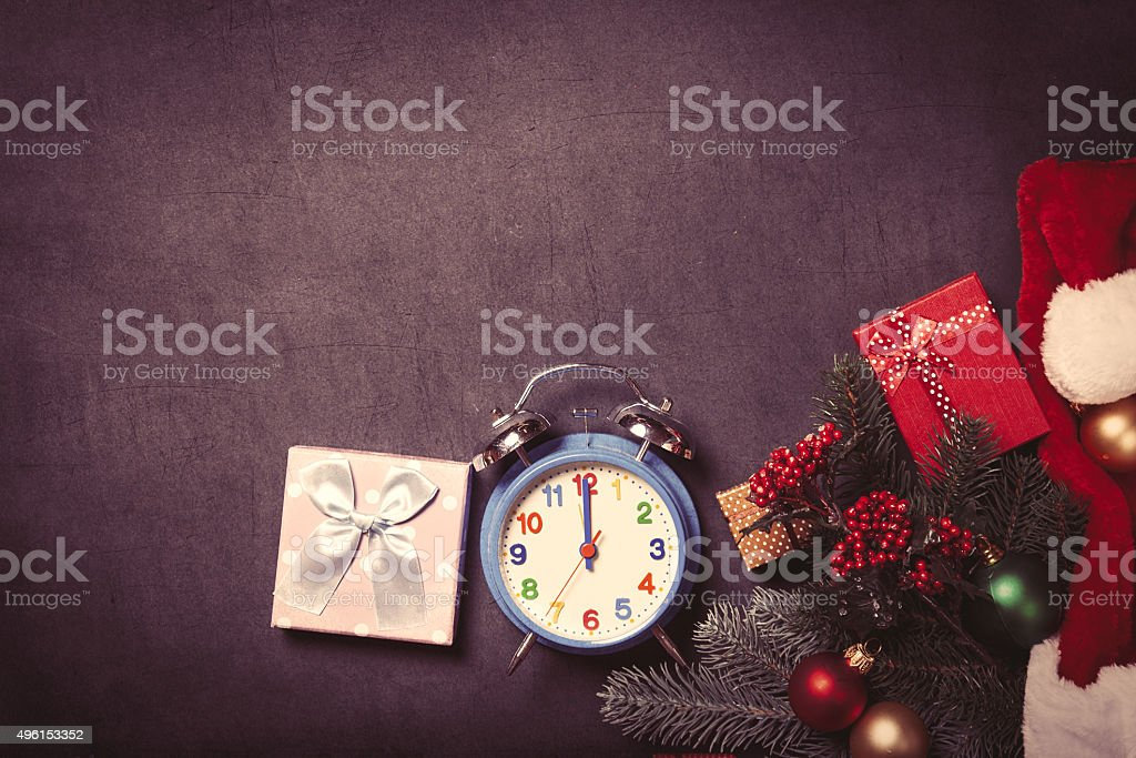 Alarm clock and Christmas gifts stock photo