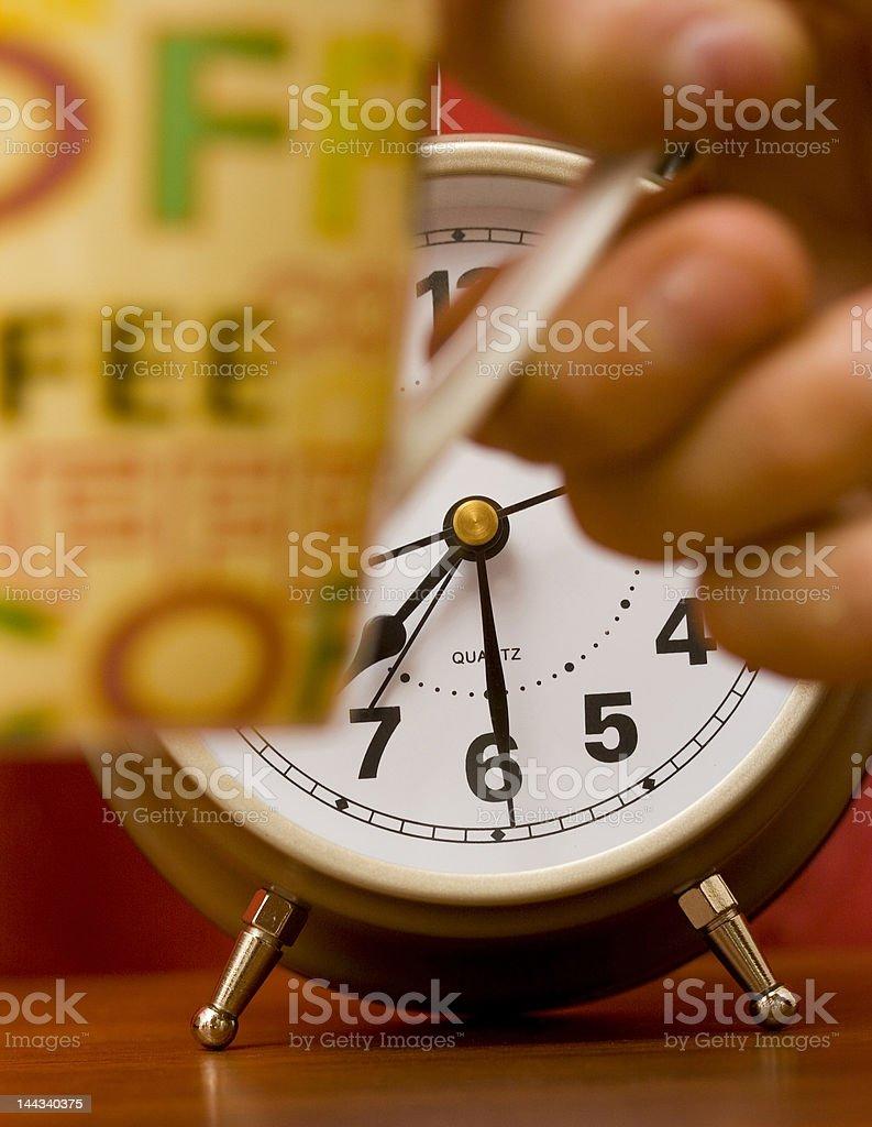 Alarm clock and coffee royalty-free stock photo