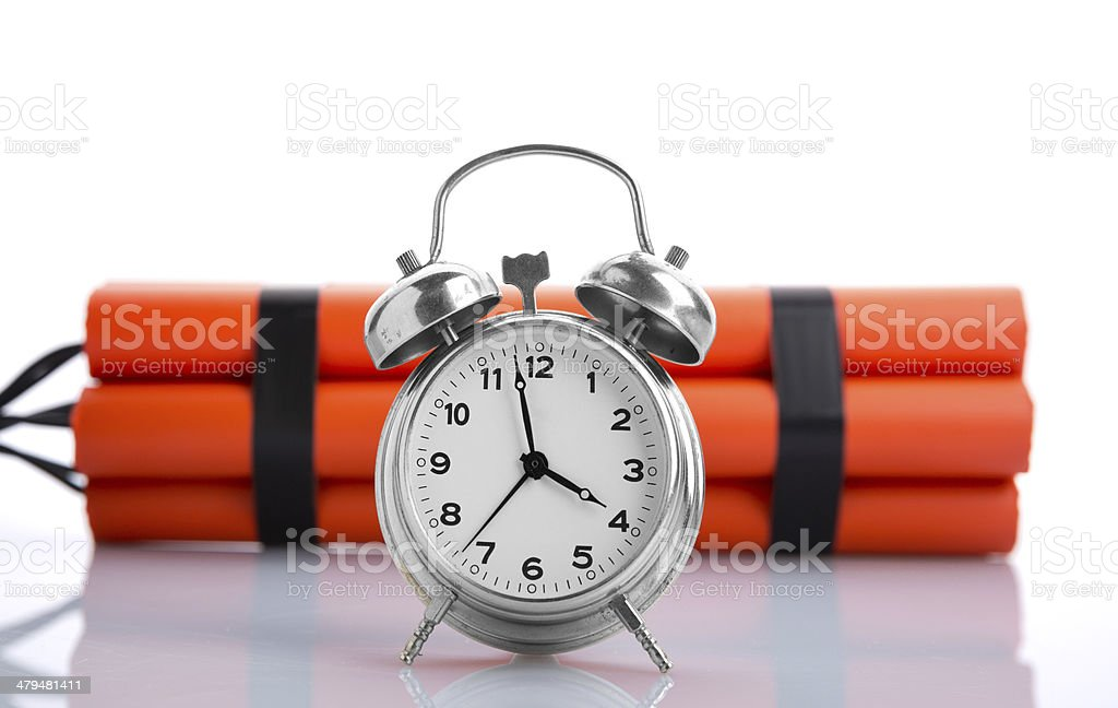 Alarm clock and dynamite royalty-free stock photo
