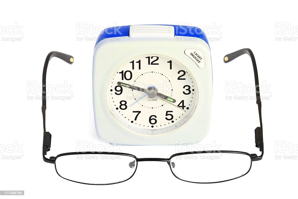 Alarm clock and glasses royalty-free stock photo