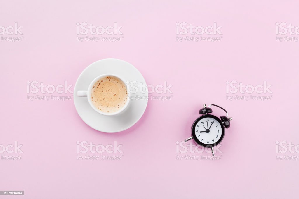Alarm clock and morning coffee. Time to rest. Flat lay. stock photo