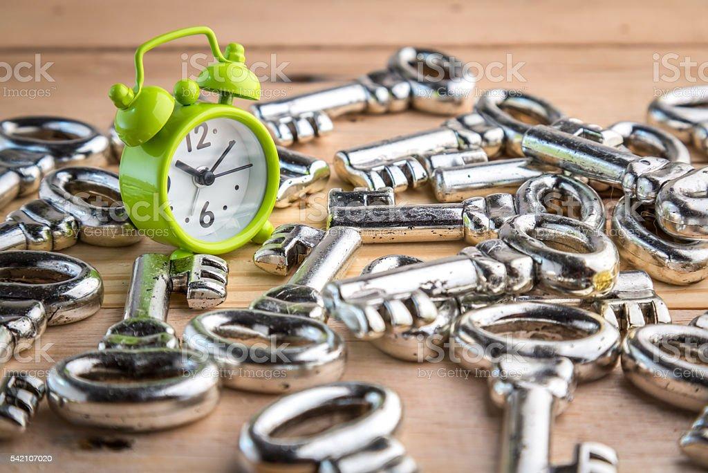 alarm clock and pile of keys stock photo