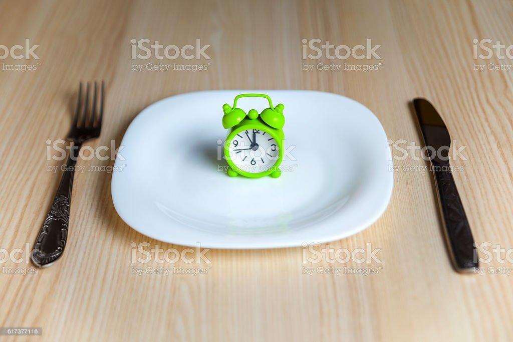 Alarm clock and utensils stock photo