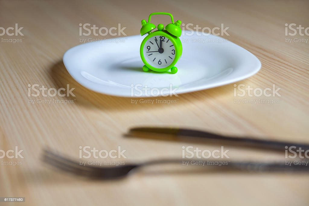 Alarm clock and utensils stock photo